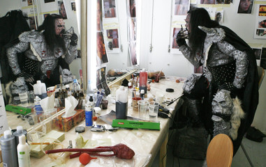 "Finnish musician Tomi Petteri Putaansuu finishes his makeup for his character ""Mr Lordi"" on the set of the horror movie ""Dark Floors"" in Oulu"