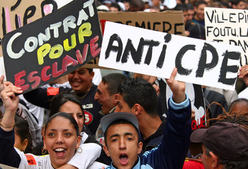 French students hold placards during a protest against CPE in Marseille