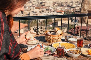 Woman taste traditional turkish breakfast in Cappadocia