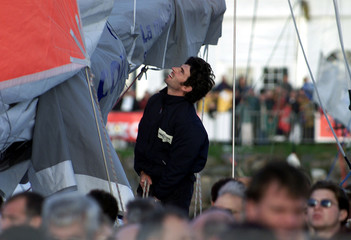French skipper Thierry Dubois is seen aboard his boat as thousands of visitors pass by at Les Sables..