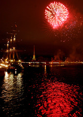 Fireworks burst over the Neva River with Peter and Pavel Fortress in the background in St.Petersburg.
