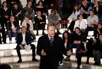 French President Jacques Chirac answers questions during a live televised debate in Paris.