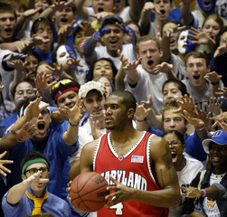 MARYLAND'S TRAVIS GARRISON IS TAUNTED BY DUKE FANS AS HE LOOKS TO MAKE AN INBOUNDS PASS.