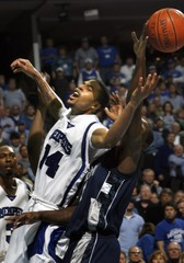 University of Memphis guard Douglas-Roberts is fouled under basket by Georgetown Hoyas guard Sapp during NCAA game in Memphis