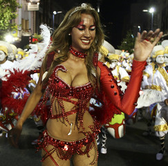 """A member of a """"comparsa"""", an Uruguayan carnival group, dances during the inaugural parade of the Uruguayan Carnival"""