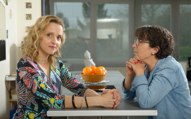 woman in kitchen talking with friend