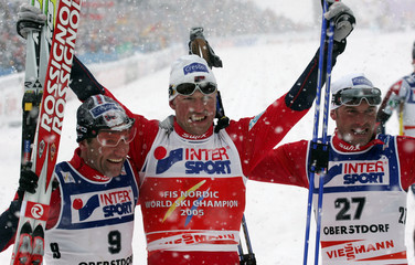 Norway's Hjelmeset, Estil and Aukland celebrate after men's 50km cross country race in Oberstdorf.