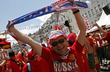A Russian soccer fan cheers for his country before the Euro 2008 match between Russia and Spain in Innsbruck