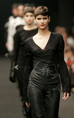 Models present creations by Portuguese designer Jose Antonio Tenente during the Autumn Winter 2006 L..