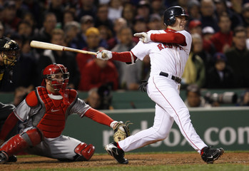 Boston Red Sox Jed Lowrie hits a game and series winning RBI in the ninth inning against the Los Angeles Angels in Boston