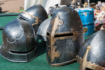 Helmets of knight armor on display for sale