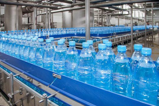 conveyor for bottling water from plastic bottles