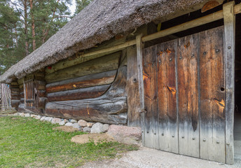 Facade of a very old wooden house in the countryside in Estonia