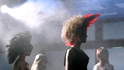 Models present creations of hairdressers during a hair show in Sofia