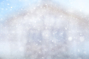 Snowfall texture of snowflakes on blurred background