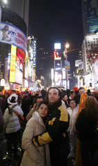 A couple hugs just after midnight at Times Square during New Year festivities in New York