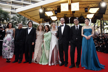 """Jury members pose on the red carpet as they arrive for the screening of the animated film """"Up"""" by director Pete Docter on the opening night in Cannes"""