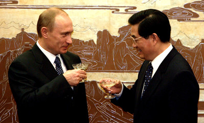 Chinese President Hu Jintao and Russian President Vladimir Putin toast after a signing ceremony in Beijing.