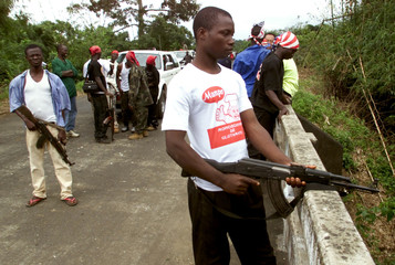 REBELS ON THE BRIDGE WHICH DIVIDES REBELAND PEACEKEEPER POSITIONS ATTHE PO RIVER, WEST OF MONROVIA.