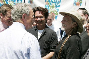 Musicians Nelson and Mellencamp speak with New York Mayor Bloomberg after a news conference to announce the Farm Aid concert schedule in New York
