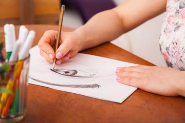 Closeup of drawing human eye at the desk