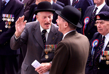 BRITISH VETERANS SPEAK TOGETHER DURING SMALL VESSELS COMMEMORATION IN DUNKIRK.