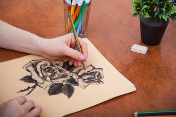 Closeup of drawing roses at the desk