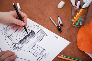 Closeup of drawing building at the desk