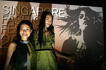 Designer Vivienne Tam and Japanese model Ai Tominaga pose for photographers during a news conference for the Singapore Fashion Festival