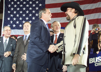 BUSH SHAKES HANDS WITH ENTERTAINER HANK WILLIAMS JR.