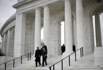 U.S. President-elect Barack Obama and Major General Richard Rowe walk down the stairs after laying a wreath at the Tomb of the Unknowns at Arlington Cemetery in Arlington, Virginia