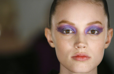 A model waits to have make up applied backstage before the start of the Heatherette fall show during New York Fashion Week