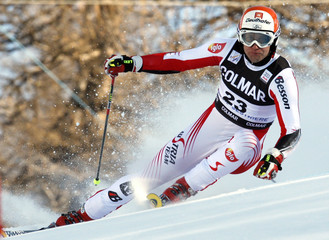 Baumann of Austria clears a gate during the giant slalom event in the men's Alpine Skiing World Cup in Sestriere