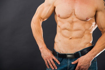 Male muscular torso with six pack abs