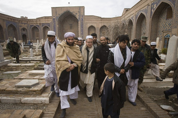 Williams, American manager of Supreme Oil and Energy company, walks to Khajeh Abdullah Ansari's tomb in Herat