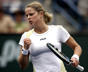 Kim Clijsters hits a forehand at the Pacific Life Open.