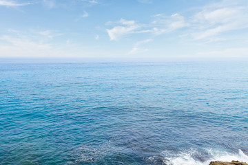 beautiful seascape with deep  calm ocean  waters and cloudscape at early morning