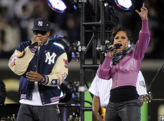 Recording artists Alicia Keys and Jay-Z entertain baseball fans at Yankee Stadium before the start of Game 2 of the 2009 Major League Baseball World Series in New York