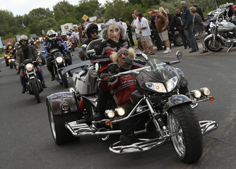 Bikers take part in a parade at the International Harley-Davidson festival in Alsoors