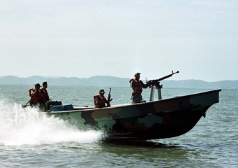 Nicaraguan Navy troops patrol the shore along the border with Honduras, where Honduran and Nicaragua..