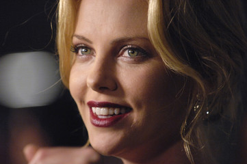"""Cast member Charlize Theron is interviewed at  the Los Angeles premiere of """"In the Valley of Elah"""" in Hollywood"""