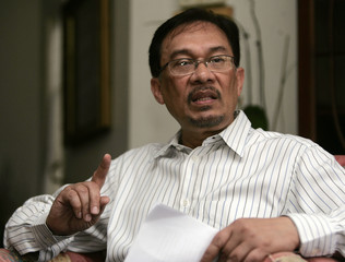 Malaysian opposition figure Anwar gestures during a news conference in Kuala Lumpur