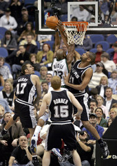 Spurs Duncan blocks shot by Timberwolves Hassell