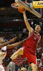 Miami Heat Antoine Walker pulls Houston Rockets Yao Ming shirt as he goes up for a shot during fourth quarter NBA basketball action in Miami