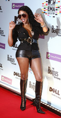 Lil' Kim poses on the red carpet before the MTV Europe Awards ceremony in Berlin