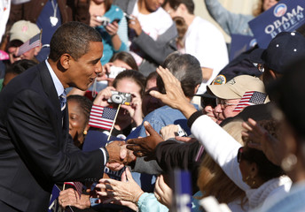 US Democratic presidential nominee Senator Barack Obama (D-IL) greets supporters at a campaign rally at the Ross County Courthouse in Chillicothe