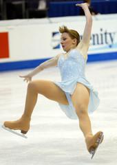 SARAH HUGHES FALLS DURING QUALIFYING SKATE AT WORLD CHAMPIONSHIPS.