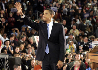 Democratic US presidential candidate Senator Obama waves to the crowd following his campaign speech at the University of Toledo in Toledo