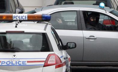 "Suspected Basque separatist rebel group ETA military chief Garikoitz Aspiazu Rubina, known as ""Txeroki"" or ""Cherokee"" is driven by hooded police as he leaves Bayonne police station to the Biarritz' airport"