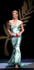 Oscar-winning South African actress Charlize Theron walks on stage near the palme d'or symbol at the..